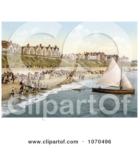 Photochrom of People Crowding on the Beach as a Yacht Starts Off From Clacton-on-Sea, Essex, England - Royalty Free Historical Stock Photography by JVPD