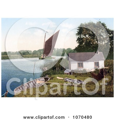 Photochrom of Sailboat on the Bure River Near a Hut in Norfolk England - Royalty Free Historical Stock Photography by JVPD
