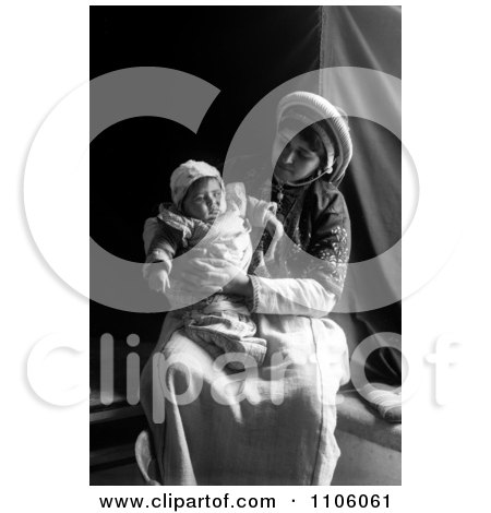 Ramallah Woman Holding Her Baby In Her Lap - Royalty Free Historical Stock Photo by JVPD