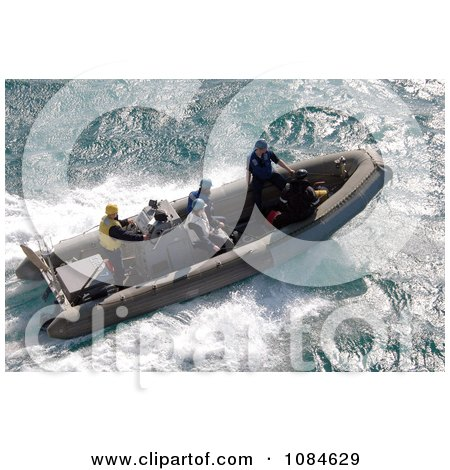 Ridged Hulled Inflatable Boat Departing The Amphibious Assault Ship USS Iwo Jima (LHD 7) - Free Stock Photography by JVPD