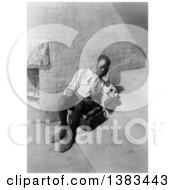 Royalty Free Black And White Historical Stock Photo Of An Exhausted African American Boy Seated On Steps With Shoe Shine Box Resting While He Has A Chance 1901 by JVPD