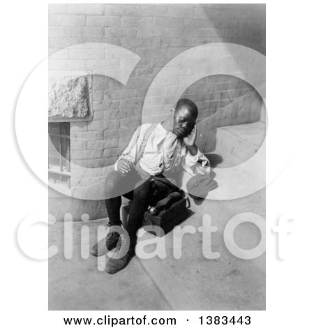 Royalty-free Black and White Historical Stock Photo of an Exhausted African American Boy Seated on Steps with Shoe Shine Box, Resting While He Has a Chance, 1901 by JVPD