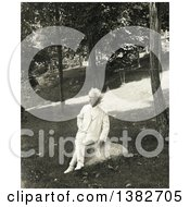 Royalty Free Historical Photo Of Mark Twain Samuel Langhorne Clemens Sitting On A Rock Outside And Smoking A Cigar by JVPD