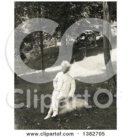 Royalty Free Historical Photo of Mark Twain, Samuel Langhorne Clemens, Sitting on a Rock Outside and Smoking a Cigar by JVPD
