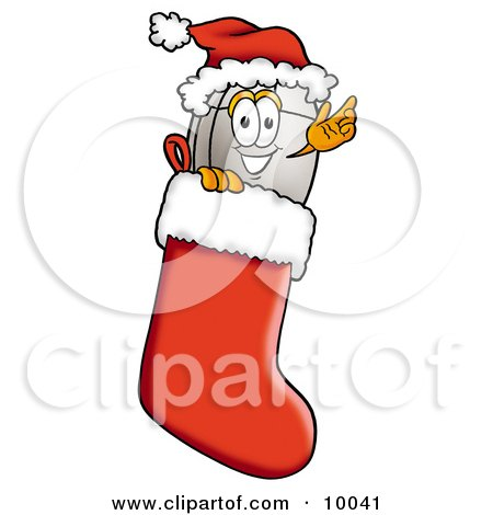 Clipart Picture of a Computer Mouse Mascot Cartoon Character Wearing a Santa Hat Inside a Red Christmas Stocking by Toons4Biz