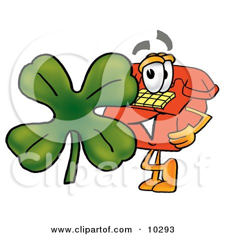 Clipart Picture of a Red Telephone Mascot Cartoon Character With a Green Four Leaf Clover on St Paddy's or St Patricks Day by Toons4Biz