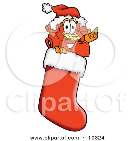 Clipart Picture of a Red Telephone Mascot Cartoon Character Wearing a Santa Hat Inside a Red Christmas Stocking by Toons4Biz