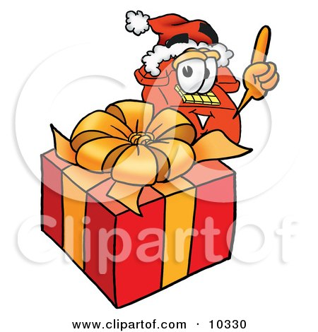 Clipart Picture of a Red Telephone Mascot Cartoon Character Standing by a Christmas Present by Toons4Biz