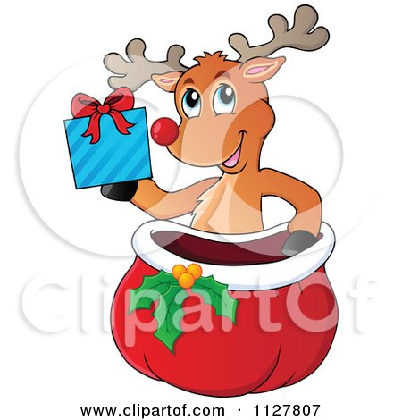 Cartoon Of A Cute Reindeer Holding A Gift Over A Sack - Royalty Free Vector Clipart by visekart