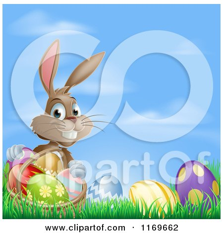 Cartoon of a Grinning Easter Bunny with Eggs and a Basket in Grass over Blue Sky - Royalty Free Vector Clipart by AtStockIllustration