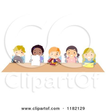 Cartoon Of Diverse School Children Sitting At A Shared