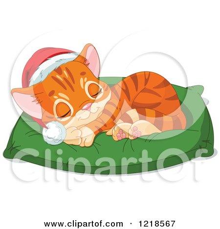 Cute christmas ginger kitten sleeping on a pillow
