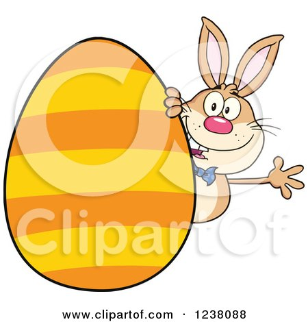 Clipart of a Brown Rabbit Waving Around a Giant Orange Striped Easter Egg - Royalty Free Vector Illustration by Hit Toon