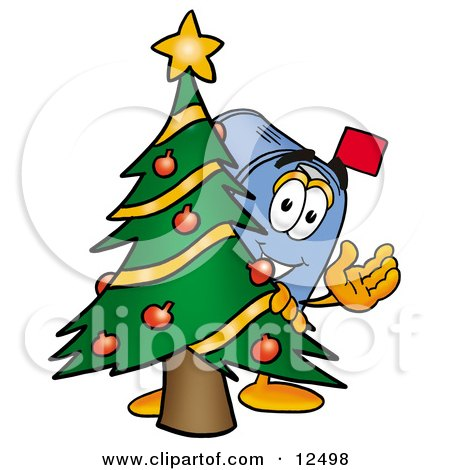 Clipart Picture of a Blue Postal Mailbox Cartoon Character Waving and Standing by a Decorated Christmas Tree by Toons4Biz