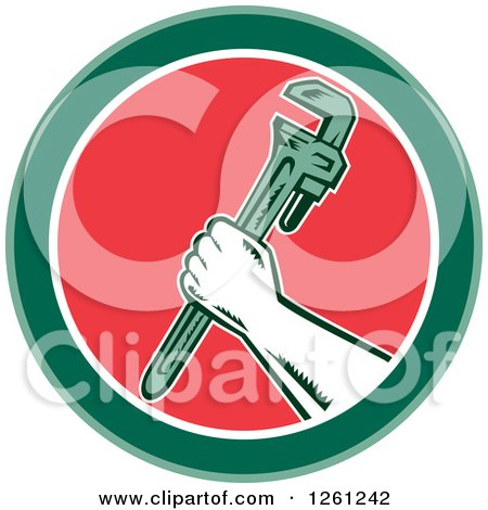 Clipart of a Retro Woodcut Plumber Hand Holding a Monkey Wrench in a Green White and Red Circle - Royalty Free Vector Illustration by patrimonio