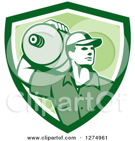 Clipart of a Retro Male Water Delivery Worker in a Green and White Shield - Royalty Free Vector Illustration by patrimonio