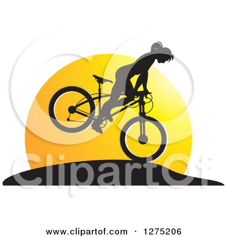 Clipart of a Silhouetted Female Mountain Biker Jumping Against a Sunset - Royalty Free Vector Illustration by Lal Perera