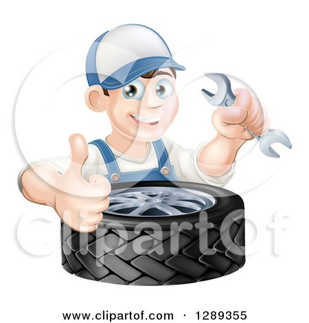 Clipart of a Happy Brunette White Mechanic Man Holding a Wrench and Thumb up over a Tire - Royalty Free Vector Illustration by AtStockIllustration