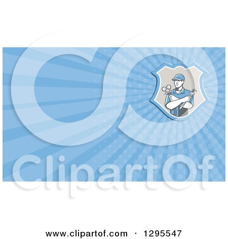 Clipart of a Retro Refrigeration Mechanic Worker Holding a Pressure Gauge and Blue Rays Background or Business Card Design - Royalty Free Illustration by patrimonio