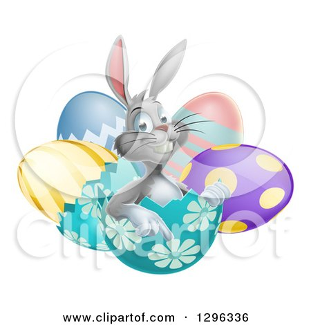 Clipart of a Happy Gray Easter Bunny Sitting and Pointing from an Egg Shell - Royalty Free Vector Illustration by AtStockIllustration