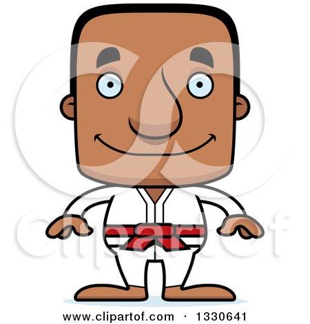 Clipart of a Cartoon Happy Block Headed Black Karate Man - Royalty Free Vector Illustration by Cory Thoman