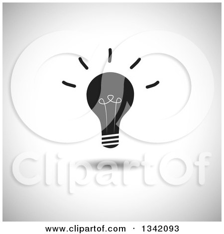 Clipart of a Shining Black Light Bulb over Shading - Royalty Free Vector Illustration by ColorMagic