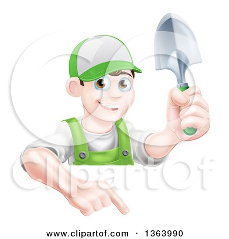 Clipart of a Happy Young Brunette White Male Gardener in Green, Pointing down over a Sign and Holding a Shovel - Royalty Free Vector Illustration by AtStockIllustration