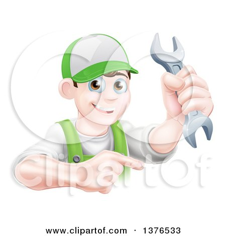 Happy Young Brunette Caucasian Mechanic Man in Green, Wearing a Baseball Cap, Holding a Wrench and Pointing Posters, Art Prints