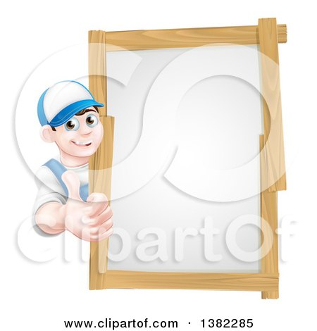 Happy Young Brunette Caucasian Mechanic Man in Blue, Wearing a Baseball Cap, Giving a Thumb up Around a Wood Framed Sign Posters, Art Prints