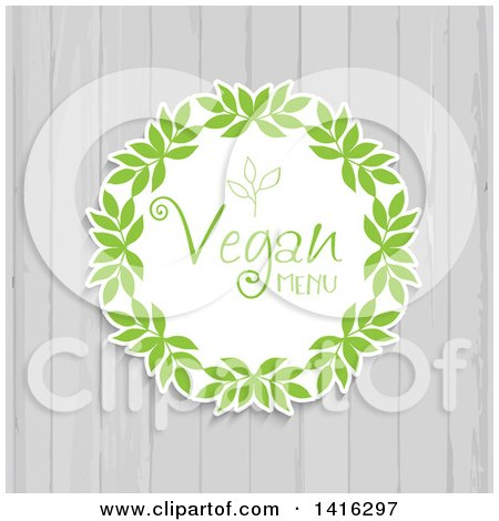 Clipart of a Round Leaf Vegan Menu Design over White Wood - Royalty Free Vector Illustration by KJ Pargeter