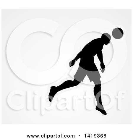 Clipart of a Black Silhouetted Male Soccer Player Head Passing a Ball, over Gray - Royalty Free Vector Illustration by AtStockIllustration