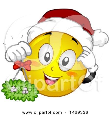 Cartoon Yellow Emoji Smiley Face Wearing a Christmas Santa Hat and Holding Mistletoe Posters, Art Prints