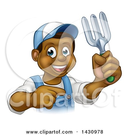 Clipart of a Cartoon Happy Black Male Gardener in Blue, Holding a Garden Fork and Pointing - Royalty Free Vector Illustration by AtStockIllustration