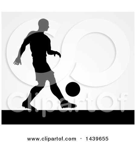 Clipart of a Black Silhouetted Male Soccer Player Kicking over Gray - Royalty Free Vector Illustration by AtStockIllustration