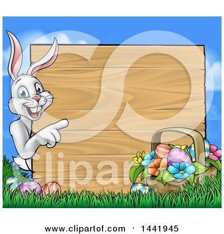 Clipart of a Cartoon Happy White Easter Bunny Rabbit Pointing Around a Wood Sign with a Basket and Eggs Against Sky - Royalty Free Vector Illustration by AtStockIllustration