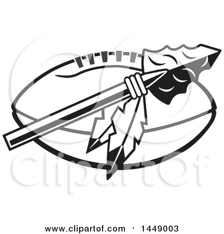 Clipart of a Black and White Arrowhead with Feathers over an American Football - Royalty Free Vector Illustration by Johnny Sajem