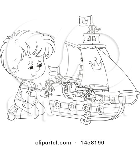 black and white boy kneeling and playing with a toy boat