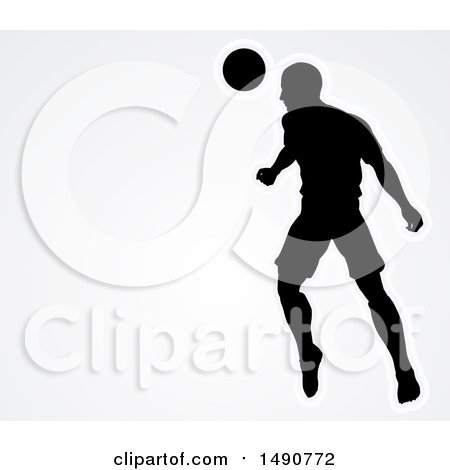 Clipart of a Silhouetted Male Soccer Player Heading a Ball over Gray - Royalty Free Vector Illustration by AtStockIllustration