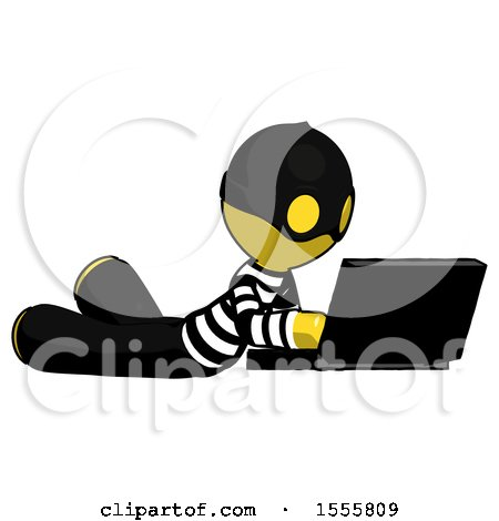 Yellow Thief Man Using Laptop Computer While Lying on Floor Side Angled View by Leo Blanchette