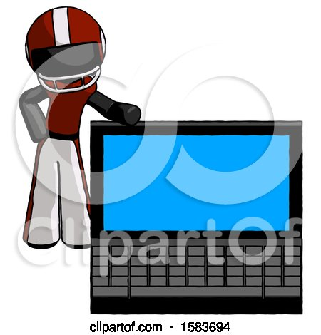 Black Football Player Man Beside Large Laptop Computer, Leaning Against It by Leo Blanchette