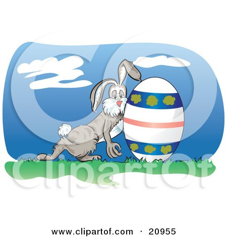 Exhuasted Bunny Rolling A Decorated Easter Egg On Grass Posters, Art Prints