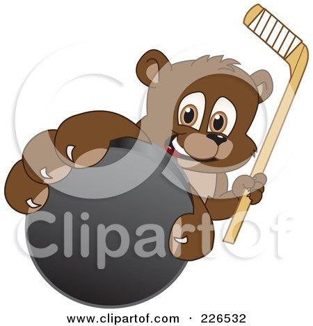 Royalty-Free (RF) Clipart Illustration of a Bear Cub School Mascot Grabbing A Hockey Puck by Toons4Biz