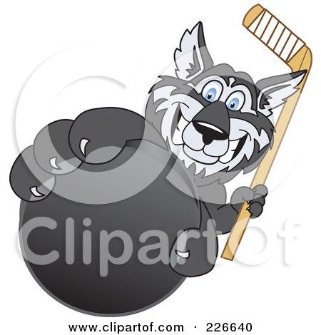 Royalty-Free (RF) Clipart Illustration of a Husky School Mascot Grabbing A Hockey Puck by Toons4Biz