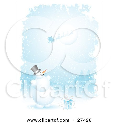 Clipart Illustration of Frosty The Snowman With A Gift, Smiling And Looking Up While Santa, His Sleigh And Reindeer Fly In Front Of The Moon On A Snowing Night by KJ Pargeter