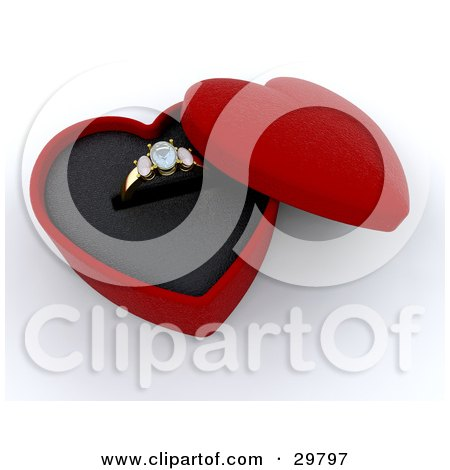 Gold Diamond Wedding Or Engagement Ring Resting In An Open Red Heart Shaped