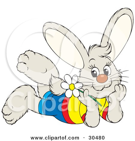 Clipart Illustration of a Happy Little Bunny Rabbit Wearing Clothes, Laying On His Belly And Day Dreaming, A White Daisy Flower In Hand by Alex Bannykh