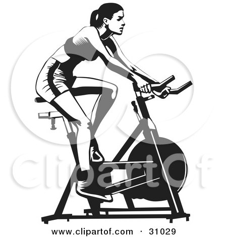 Healthy Woman Exercising On A Stationary Bicycle In A Gym Posters, Art Prints