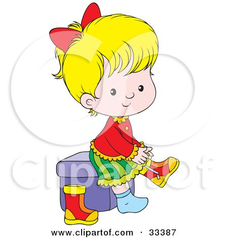 Little Blond Girl Sitting On A Cube And Putting Her Boots On Posters, Art Prints