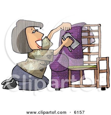 Woman Kneeling While Putting Purple Upholstery on a Chair Frame Posters, Art Prints