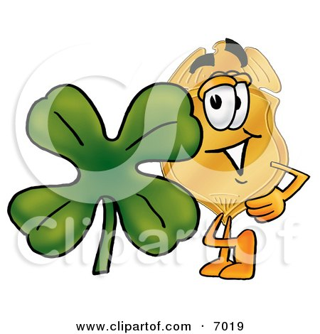 Clipart Picture of a Badge Mascot Cartoon Character With a Green Four Leaf Clover on St Paddy's or St Patricks Day by Toons4Biz